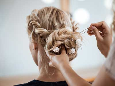 female-hairdresser-making-hairstyle-blonde-woman-beauty-salon.jpg
